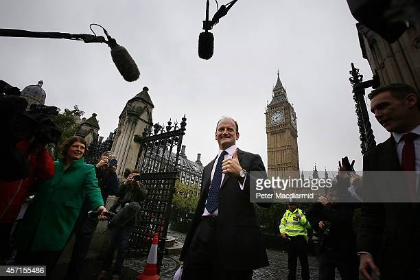 New UK Independence Party Member of Parliament Douglas Carswell gives a thumbs up to reporters as he arrives at Parliament on October 13 2014 in...
