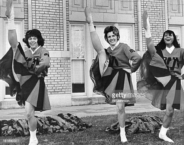 NOV 6 1964 DEC 9 1964 New Uniforms at West Members of the cheerleading corps at West High School display the group's new uniforms which feature...