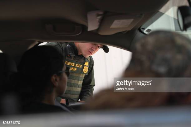 A new US Border Patrol agent checks a vehicle during a training scenario at the Border Patrol Academy on August 2 2017 in Artesia New Mexico All new...