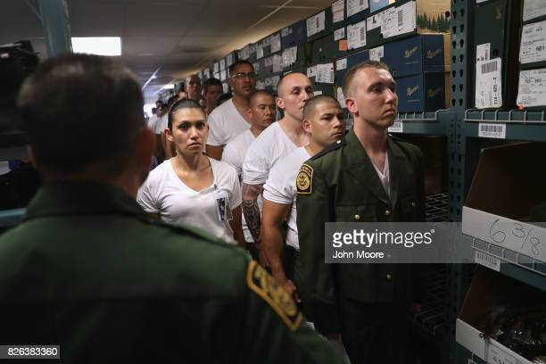 New US Border Patrol trainees wait to be fitted for uniforms at the US Border Patrol Academy on August 3 2017 in Artesia New Mexico All new agents...
