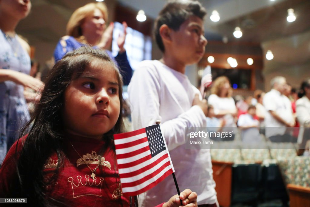 New U.S. citizen Davies Garcia (CENTER R), 11, originally from Mexico, stands with his sister Valerie (L), a U.S. citizen born in the U.S., during a naturalization ceremony conducted by U.S. Citizenship and Immigration Services (USCIS), on September 14, 2018 in Los Angeles, California. USCIS presented citizenship papers at the L.A. Public Library to around 50 young people who obtained their citizenship via their parents. Some of the young people became citizens once their immigrant parents became citizens while others were adopted by citizens of the U.S. The ceremony was part of annual Constitution Week and Citizenship Day celebrations conducted by USCIS.
