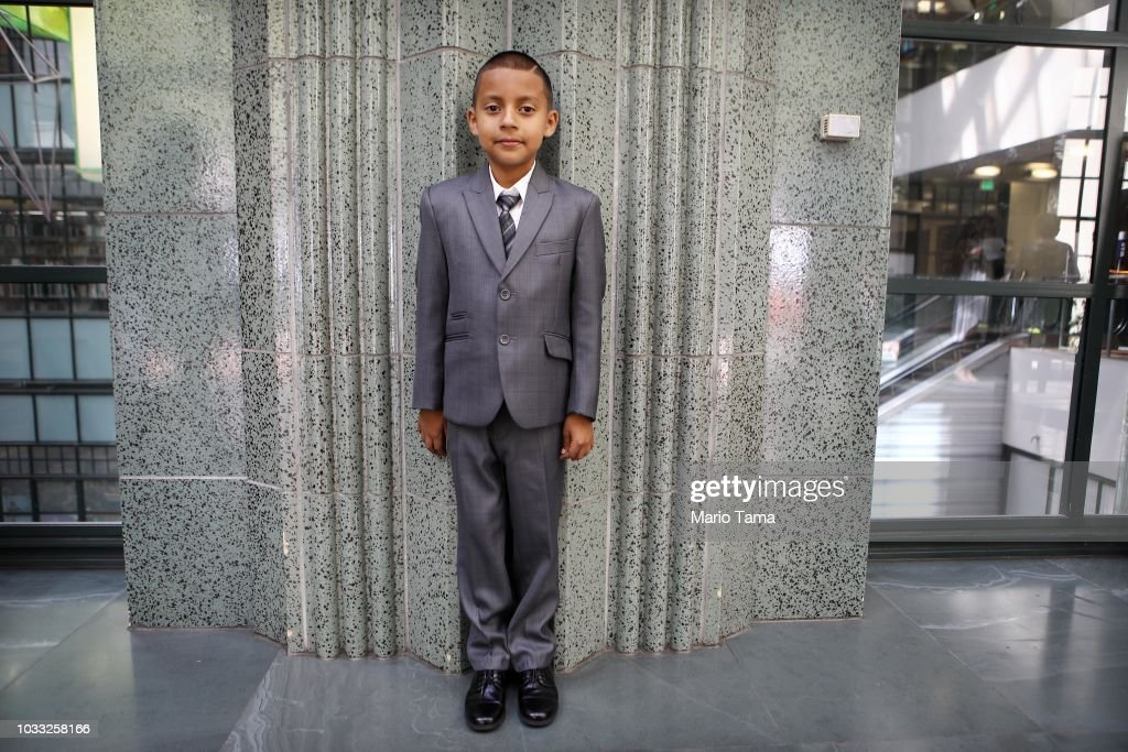 New U.S. citizen Joaquin Martinez, 8, originally from Mexico, poses following a naturalization ceremony conducted by U.S. Citizenship and Immigration Services (USCIS), on September 14, 2018 in Los Angeles, California. USCIS presented citizenship papers at the L.A. Public Library to around 50 young people who obtained their citizenship via their parents. Some of the young people became citizens once their immigrant parents became citizens while others were adopted by citizens of the U.S. The ceremony was part of annual Constitution Week and Citizenship Day celebrations conducted by USCIS.