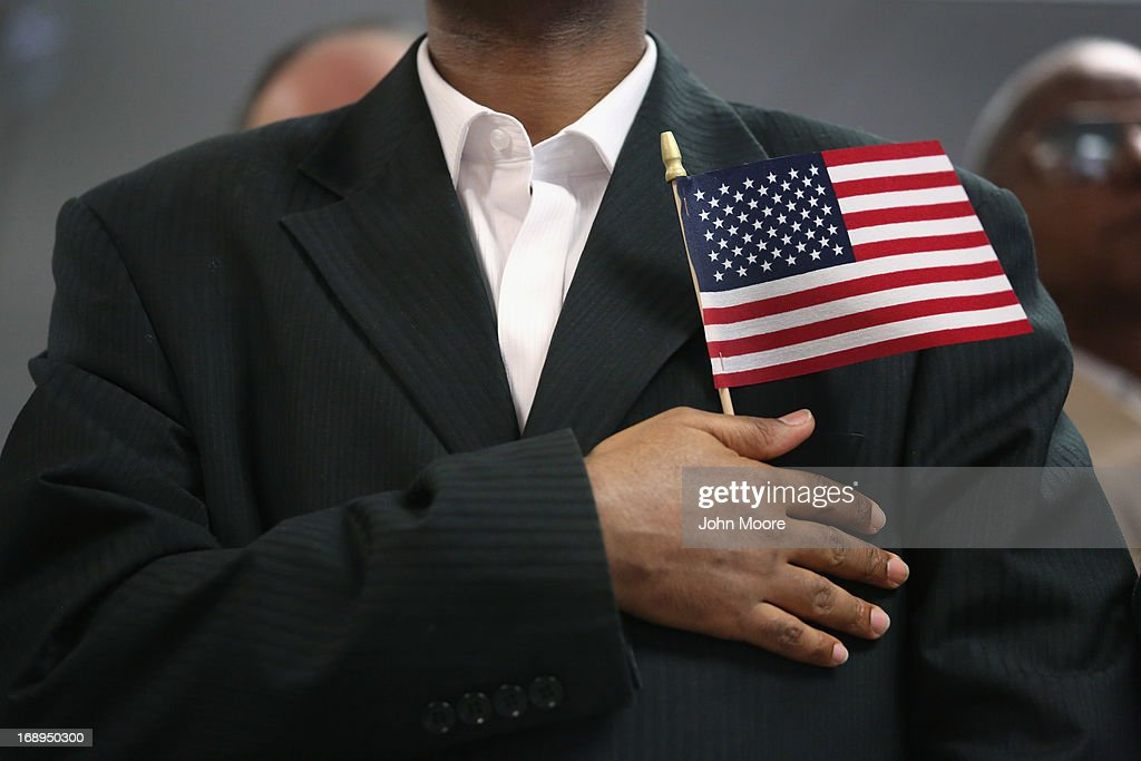 A new U.S. citizen stands while reciting the pledge of allegiance after becoming an American citizen at a naturalization ceremony held at the U.S. Citizenship and Immigration Services (USCIS), office on May 17, 2013 in New York City. One hundred and fifty immigrants from 38 different countries became U.S. citizens at the event. Some 11 million undocumented immigrants living in the U.S. stand to eventually gain American citizenship if Congress passes immigration reforms currently being negotiated in Washington D.C.