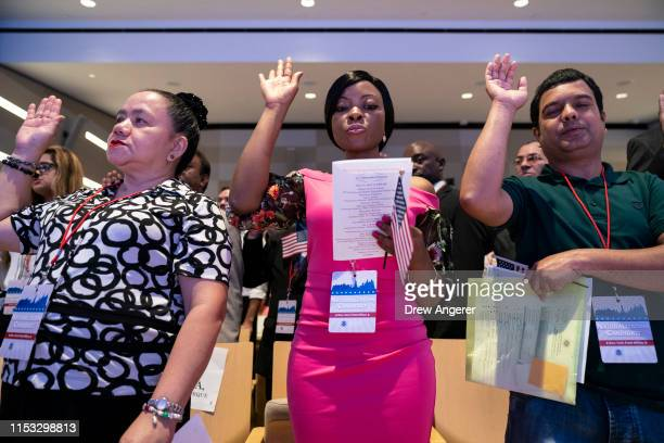 New U.S. Citizens recite the Oath of Allegiance during a naturalization ceremony inside the National September 11 Memorial Museum on July 2, 2019 in...