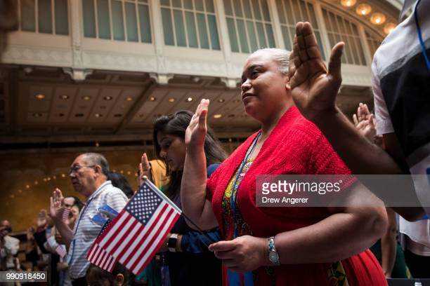 New US citizens recite the Oath of Allegiance during naturalization ceremony at the New York Public Library July 3 2018 in New York City 200...