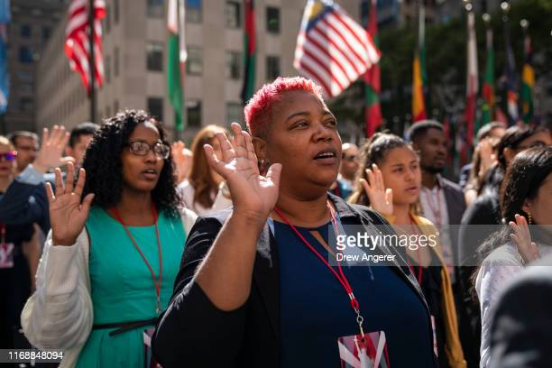 New U.S. Citizens recite the the Oath of Allegiance during a naturalization ceremony at Rockefeller Center on September 17, 2019 in New York City....