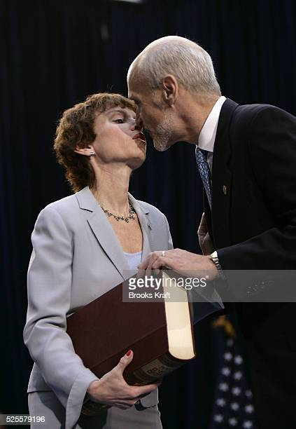 New US Department of Homeland Security Secretary Michael Chertoff right kisses his wife Meryl after being swornin by US at a ceremony in Washington...