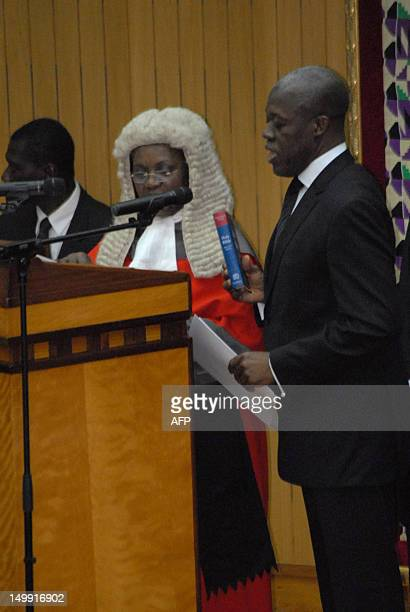 New Vice President of Kwesi Bekoe AmissahArthur takes the oath during the swearing in ceremony in Accra on August 6 2012 Former central bank governor...