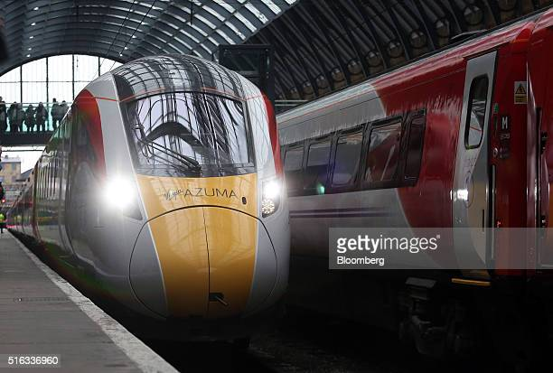 A new Virgin Azuma high speed train manufactured by Hitachi Ltd arrives at Kings Cross station London UK on Friday March 18 2016 Virgin Trains will...
