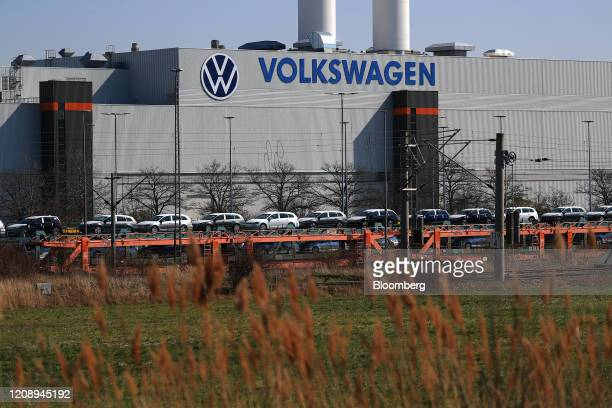 New Volkswagen AG automobiles are transported on a railway vehicle carrier outside the inactive VW automobile factory in Zwickau, Germany, on...
