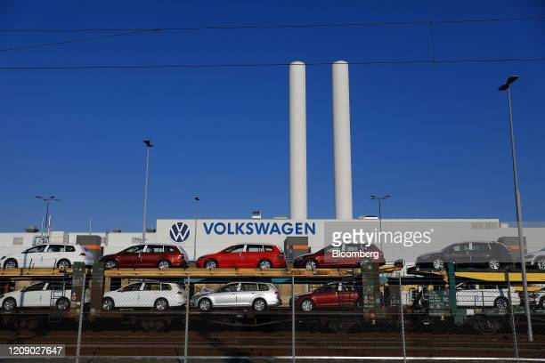 New Volkswagen AG Passat automobiles are transported on a railway vehicle carrier outside the inactive VW automobile factory in Zwickau, Germany, on...