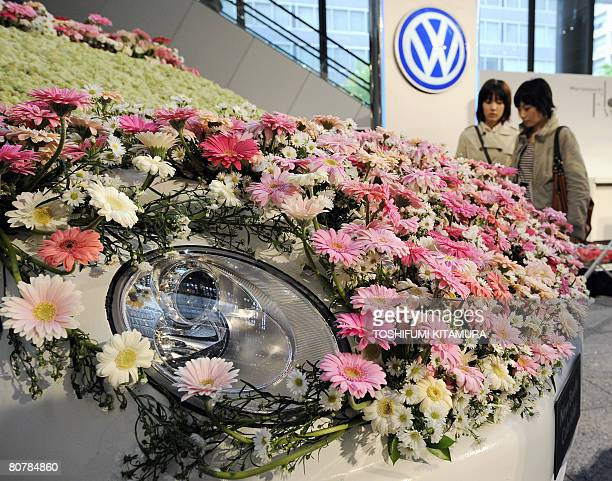 A new Volkswagen Beetle is decorated by flowers during the Flower Weeks 2008 event at the Marunouchi shoping district in central Tokyo on April 20...