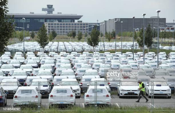 New Volkswagen cars stand parked on an openair parking lot at BER Willy Brandt Berlin Brandenburg International Airport near Berlin on August 14 2018...