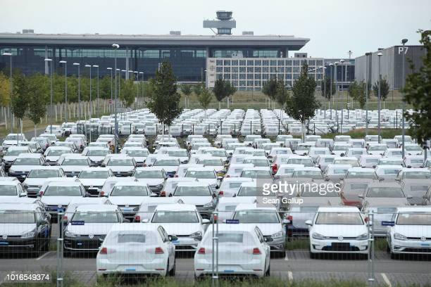 New Volkswagen cars stand parked on an openair parking lot at BER Willy Brandt Berlin Brandenburg International Airport near Berlin on August 14 2018...