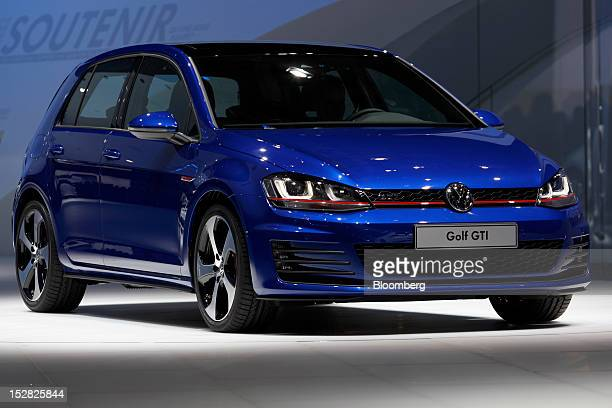 A new Volkswagen Golf GTI automobile produced by Volkswagen AG sits on display on the first day of the Paris Motor Show in Paris France on Thursday...