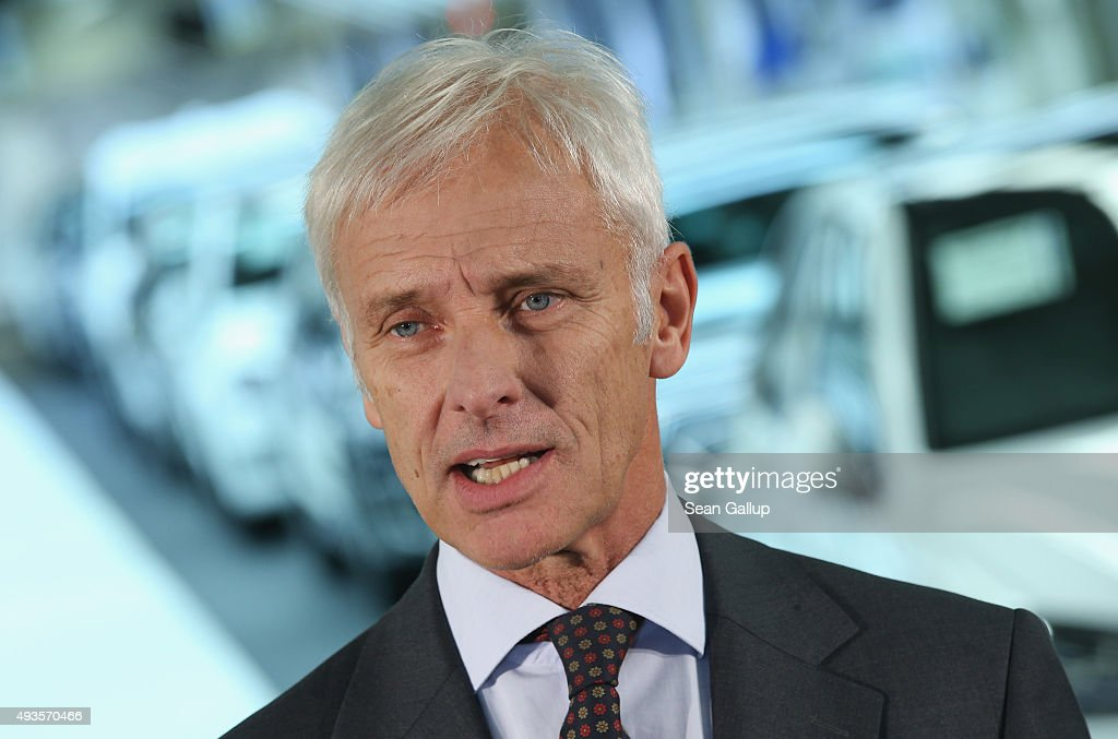 New Volkswagen Group Chairman Matthias Mueller speaks to the media with Volkswagen Work Council head Bernd Osterloh and Lower Saxony Governor Stephan Weil (both not pictured) while standing at the assembly line of the Volkswagen factory on October 21, 2015 in Wolfsburg, Germany. The three toured the plant and met with workers as Volkswagen continues to struggle through the wake of the Volkswagen diesel emissions scandal. The company installed software that cheats during emissions test into 11 million of its diesel cars sold worldwide.