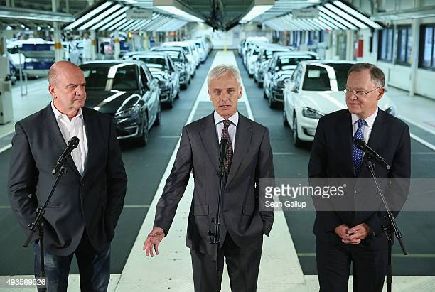 New Volkswagen Group Chairman Matthias Mueller , Volkswagen Work Council head Bernd Osterloh and Lower Saxony Governor Stephan Weil speak to the...