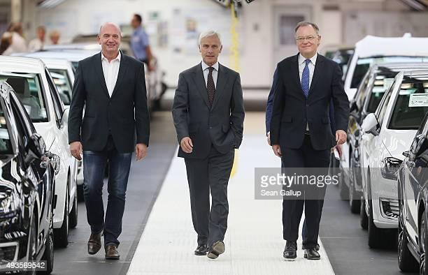 New Volkswagen Group Chairman Matthias Mueller Volkswagen Work Council head Bernd Osterloh and Lower Saxony Governor Stephan Weil arrive to speak to...