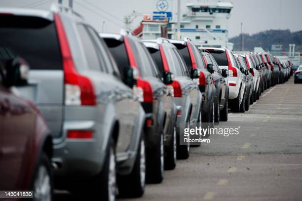 New Volvo AB automobiles stand on the dockside before shipping at the Port of Gothenburg in Gothenburg Sweden on Tuesday April 18 2012 Sweden's...