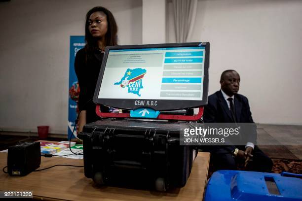 A new voting machine to be used during the Democratic Republic of the Congo's elections sits on a table beside on February 21 2018 in Kinshasa DR...