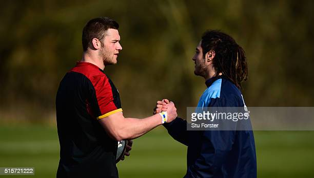 New Wales captain Dan Lydiate shakes hands with Cardiff Blues forward Josh Navidi during training ahead of their RBS 6 Nations match against Italy at...