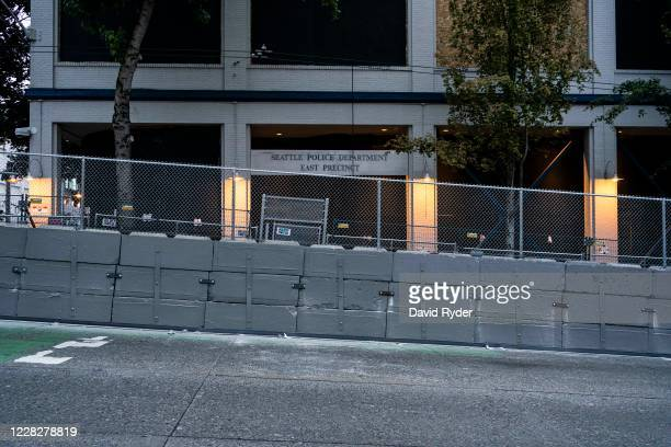 New wall outside of the Seattle Police Departments East Precinct is seen as protesters gather nearby to hear form Nicole Blake Chafetz, the aunt of...