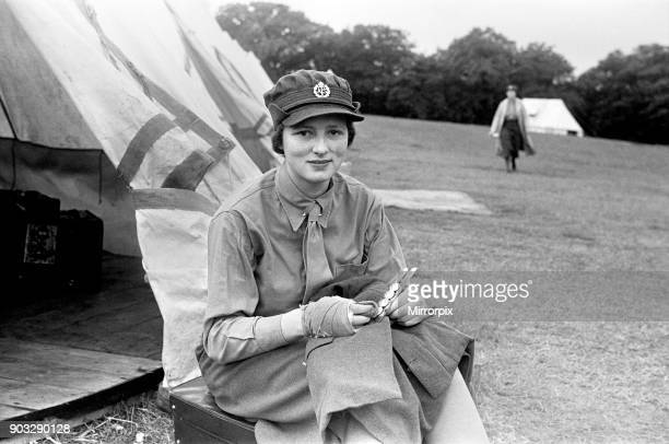 New WATS recruit at the Cowshot Manor Camp Brookwood, Surrey polishing her tunic buttons before an inspection by Sir Malcolm Fraser and Lord...