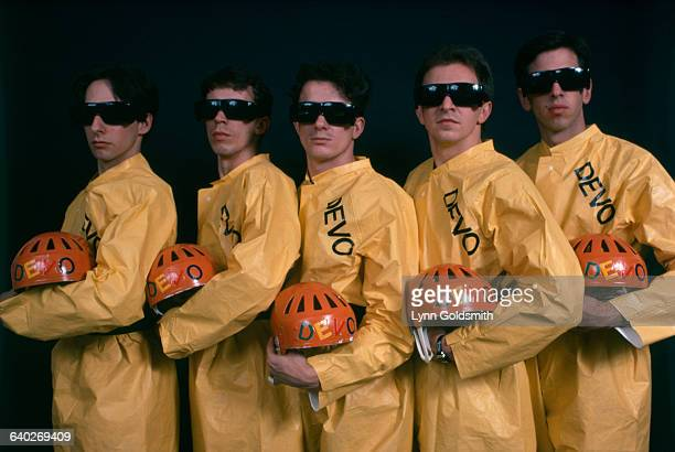 New wave band Devo wears their trademark yellow plastic jump suits