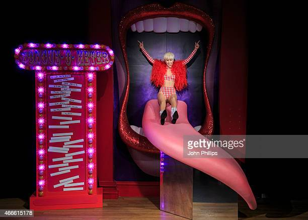 A new wax figure of Miley Cyrus is unveiled at Madame Tussauds on March 17 2015 in London England