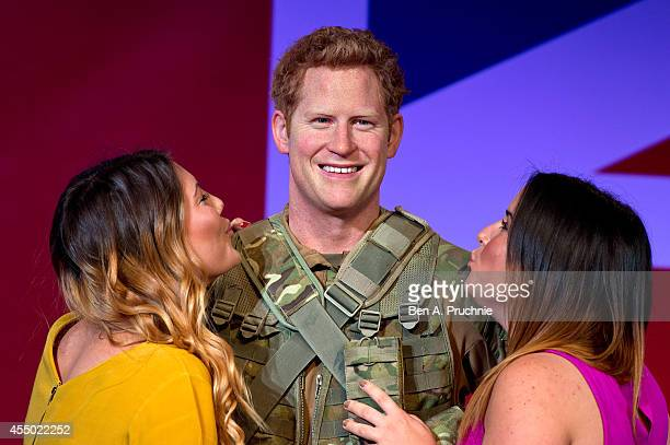 A new wax figure of Prince Harry is unveiled at Madame Tussauds on September 9 2014 in London England
