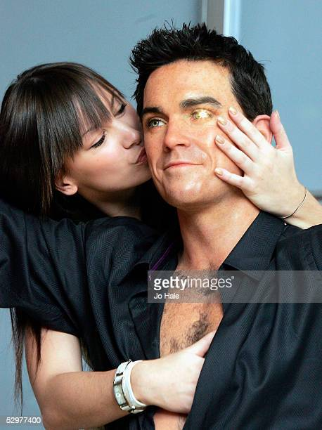 A new waxwork model of pop star Robbie Williams is unveiled as the lastest addition to Madame Tussauds at Baker Street on May 23 2005 in London