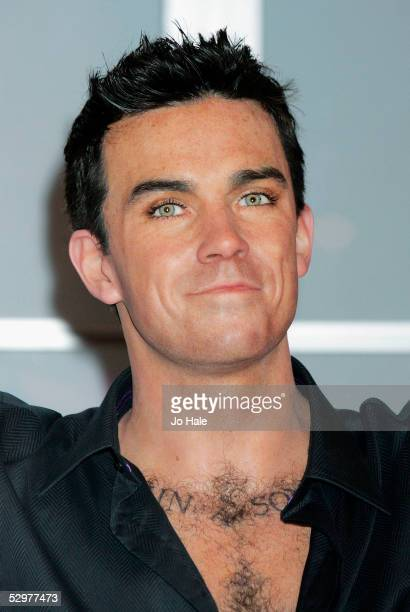 A new waxwork model of pop star Robbie Williams is unveiled as the lastest addition to Madame Tussauds at Baker Street on May 25 2005 in London