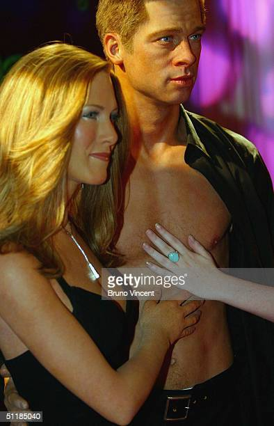 New waxworks of Hollywood couple actors Brad Pitt and Jennifer Aniston are unveiled at Madame Tussauds on August 18 2004 in London The new models of...