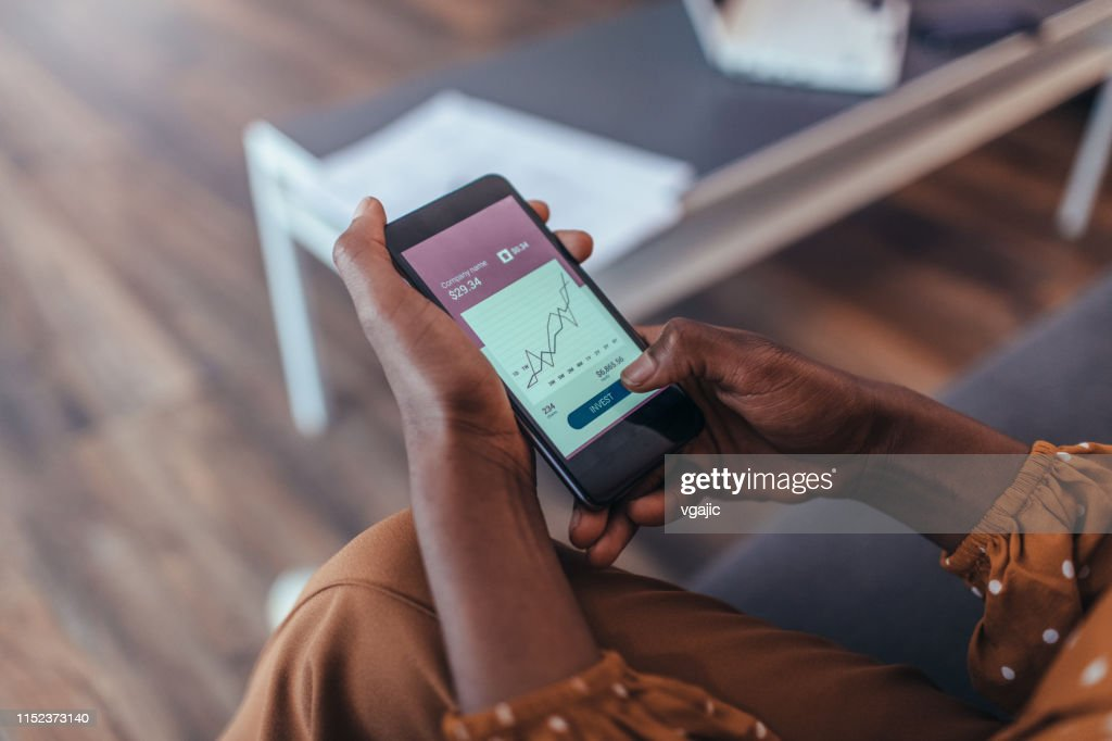 New Ways of Investing - Hands Only Using Smart Phone : Stock Photo