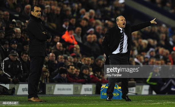 New West Brom manager Pepe Mel reacts alongside Everton manager Roberto Martinez during the Barclays premier league match between West Bromwich...