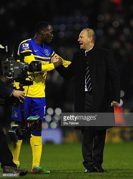 New West Brom manager Pepe Mel shares a joke with Everton forward Romelu Lukaku after the Barclays premier league match between West Bromwich Albion...