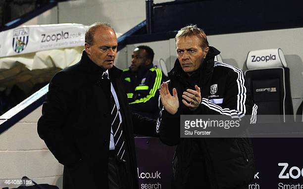 New West Brom manager Pepe Mel takes his seat as ex caretaker coach Keith Downing applauds before the Barclays premier league match between West...