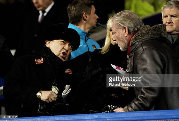 New West Ham owners David Sullivan and David Gold talk in the directors box during the Barclays Premier League match between Portsmouth and West Ham...