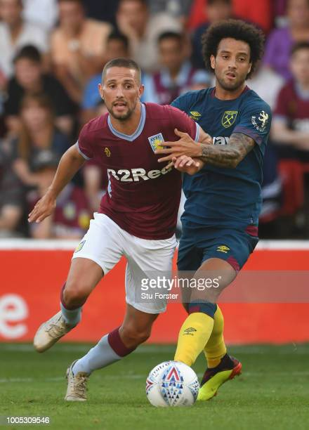 New West Ham United signing Felipe Anderson challenges Villa player Conor Hourihane during a friendly match between Aston Villa and West Ham United...