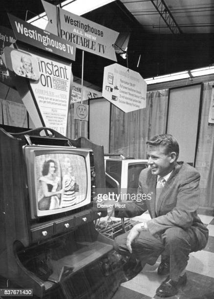 New Westinghouse Line H L Roesener electronics division manager for McCollum Law Corp demonstrates 'instant on' feature of 1962 Westinghouse 19inch...