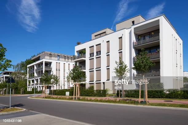 new white apartment houses - prosperity stock pictures, royalty-free photos & images