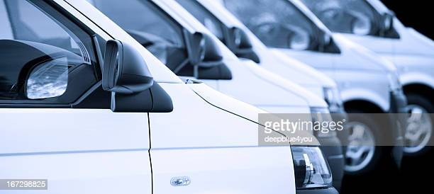 new white vans in a row on black - land vehicle stock photos and pictures