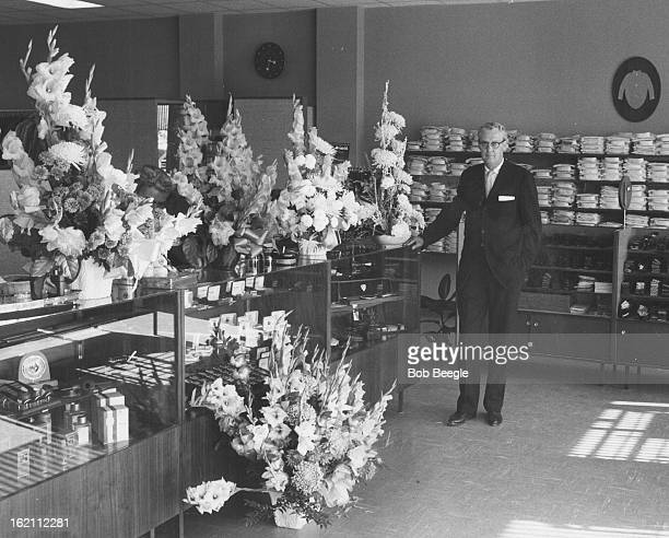AUG 17 1959 AUG 23 1959 New Wilson Store Opens Lloyd O Timblin partner in Robert Wilson Co specialists in men's and boys' wear is shown in the new...
