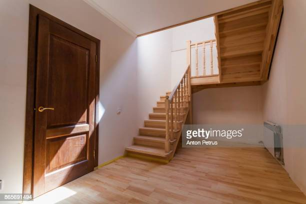 New wooden staircase in the interior of a private house