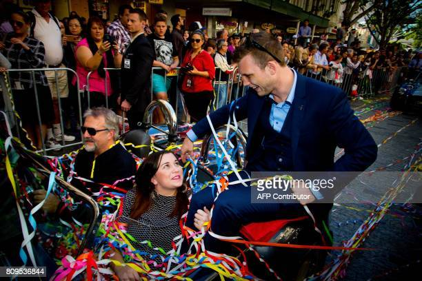 New World Boxing Organization welterweight title holder Jeff Horn and his wife Jo of Australia participate in a postmatch victory parade at...