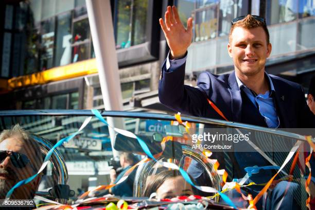 New World Boxing Organization welterweight title holder Jeff Horn waves during his postmatch victory parade at Brisbane's Queen Street Mall on July 6...