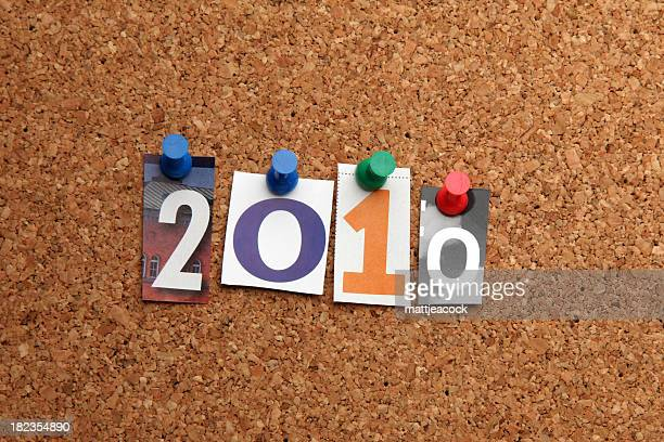 new year 2010 pinned on noticeboard - 2010 stock pictures, royalty-free photos & images