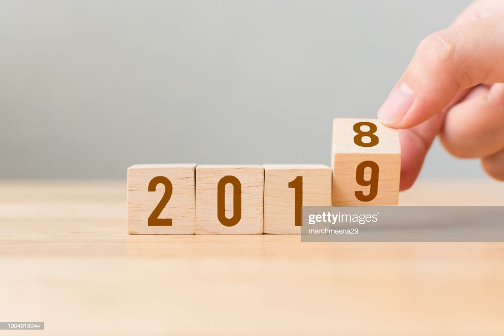 New year 2018 change to 2019 concept. Hand flip over wood cube block : Stock Photo