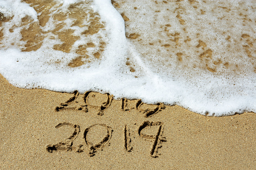 New Year 2019 and Year 2018 Written on Sandy Beach with Waves - gettyimageskorea