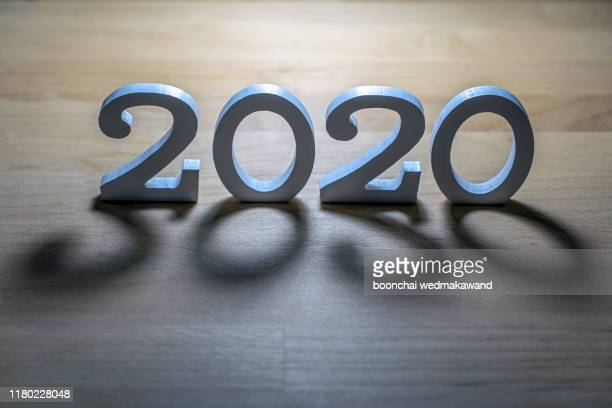new year 2019 change to 2020 concept, hand change wooden cubes - 2020 stock pictures, royalty-free photos & images